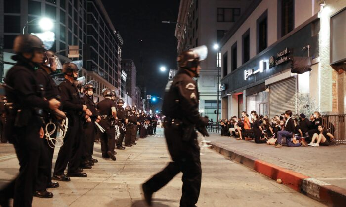 Protesters are arrested after curfew went into effect during mostly peaceful demonstrations over George Floyd's death downtown in Los Angeles, Calif. on June 2, 2020. (Mario Tama/Getty Images)