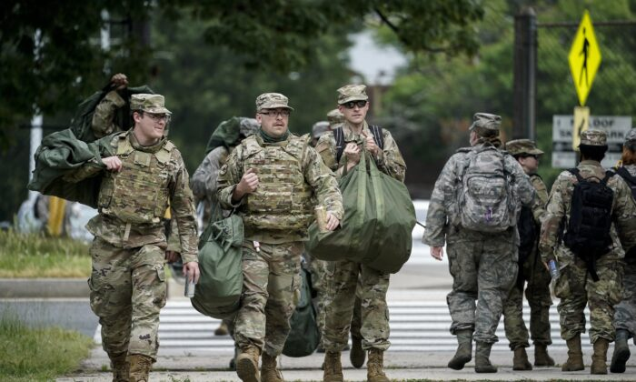 National Guard troops arrive at the Joint Force Headquarters of the D.C. National Guard in Washington on June 2, 2020. (Drew Angerer/Getty Images)
