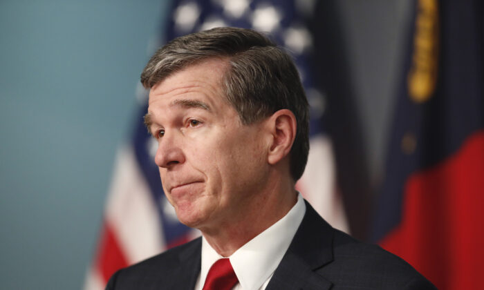 North Carolina Gov. Roy Cooper speaks during a briefing at the Emergency Operations Center in Raleigh, N.C., on June 2, 2020. (Ethan Hyman/The News & Observer via AP)