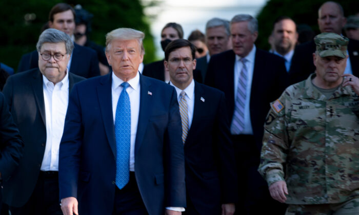 President Donald Trump walks with Attorney General William Barr, left, Secretary of Defense Mark Esper, center, Chairman of the Joint Chiefs of Staff Mark Milley, right, and others from the White House to visit St. John's Church on June 1, 2020. (Brendan Smialowski/AFP via Getty Images)