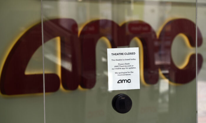 A message on the ticket window at the AMC Burbank 16 movie theaters complex informs potential customers that it is currently closed in Burbank, Calif., on April 29, 2020. (Chris Pizzello/AP photo)