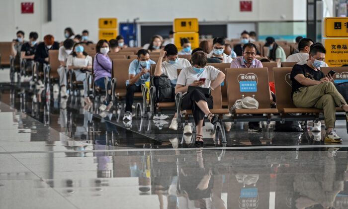 Passengers wearing protective masks sit as they wait for their flights at Tianhe Airport in Wuhan, in Chinas central Hubei province, on May 29, 2020. (Hector Retamal /AFP via Getty Images)
