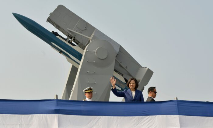 Taiwan's President Tsai Ing-wen (C) waves from the deck of the Ming Chuan frigate during a ceremony to commission two Perry-class guided missile frigates from the United States into the Taiwan Navy, in the southern port of Kaohsiung on Nov. 8, 2018. (Chris Stowers/AFP via Getty Images)