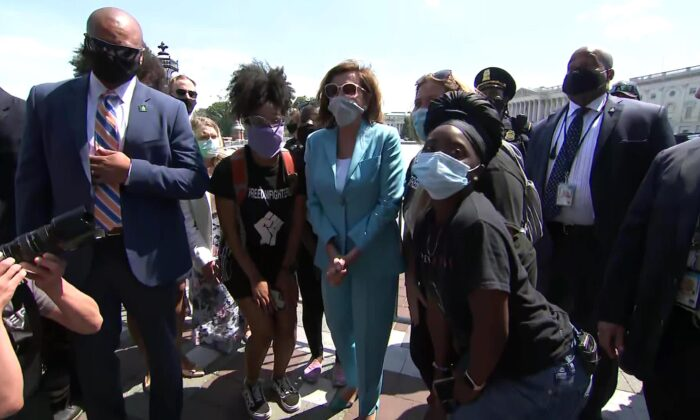 House Speaker Nancy Pelosi visits protesters outside the U.S. Capitol in Washington on June 3, 2020, to show solidarity with demonstrations following the death of George Floyd while in police custody. (CNN)