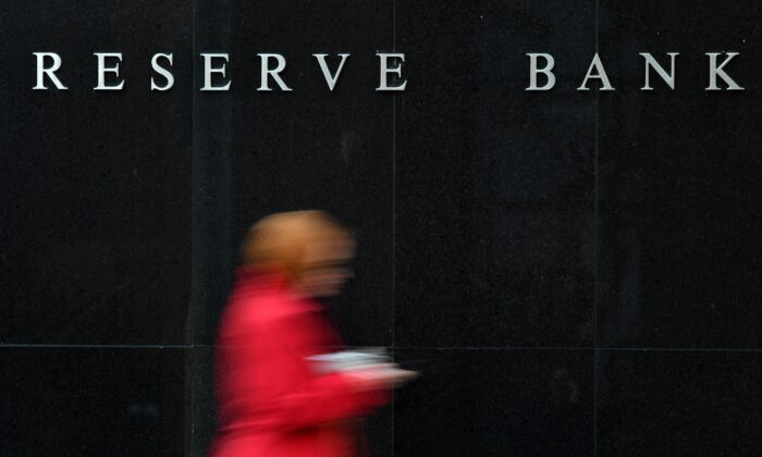 People walk past the Reserve Bank of Australia building in Sydney, Australia, on May 7, 2019. (SAEED KHAN/AFP via Getty Images)