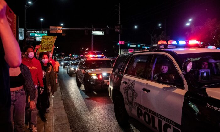 Police officers look at protesters during a Black Lives Matter protest in Las Vegas, Nev., on June 1, 2020. (Bridget Bennett/AFP via Getty Images)