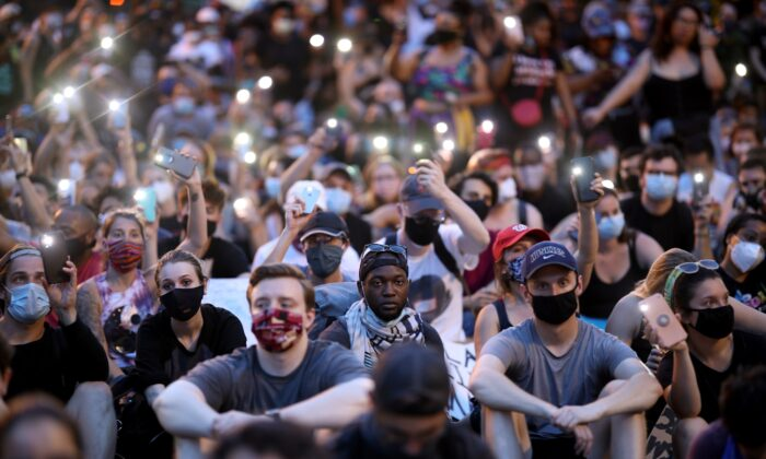 """Demonstrators sing """"Lean On Me"""" during a protest near the White House White House in Washington on June 3, 2020. (Win McNamee/Getty Images)"""
