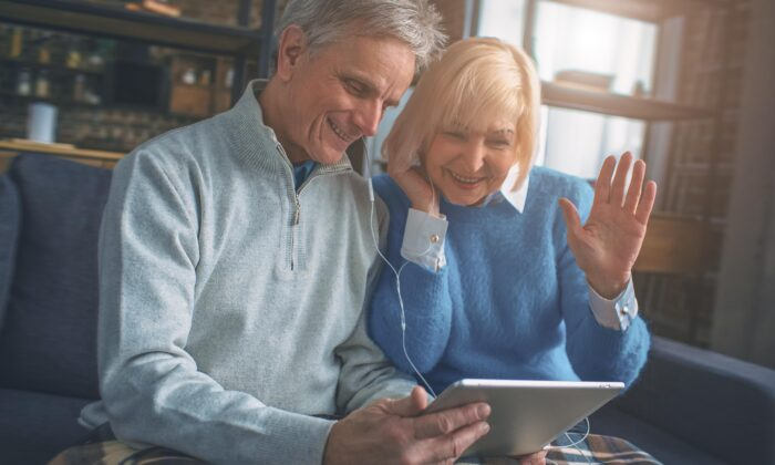 Many grandparents are doing their best to stay connected with grandchildren through video conferencing and phone calls, but these technologies are shallow replacements for real contact. (Estrada Anton/Shutterstock)