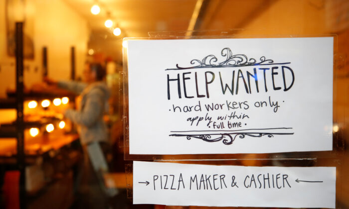"""A """"Help wanted"""" sign is seen in the window of a bakery in Ottawa, Ontario, Canada in this file photo. (Reuters/Chris Wattie)"""
