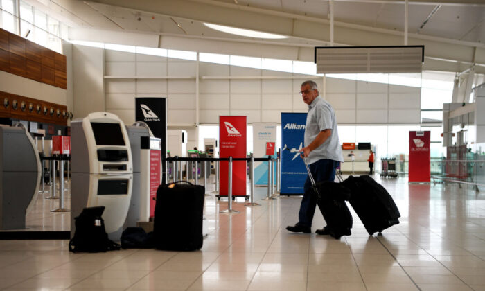 Passengers check in for a Qantas flight at Adelaide Airport on April 01, 2020 in Adelaide, Australia. (Tracey Nearmy/Getty Images)