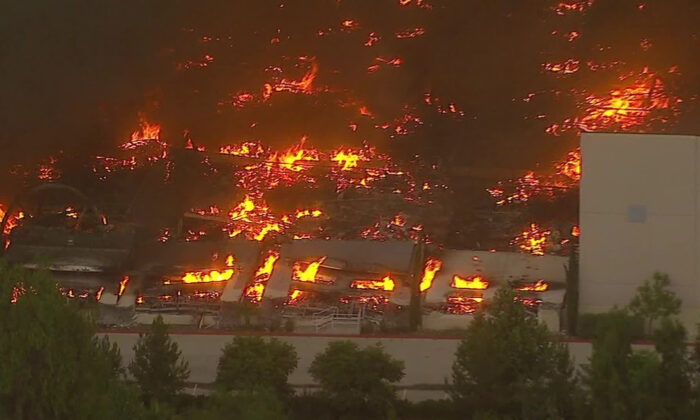A warehouse that operates as an Amazon distribution center went up in flames after a three-alarm fire broke out, engulfing the entire building in Redlands, Calif., on Jun. 5, 2020. (Courtesy of KABC)