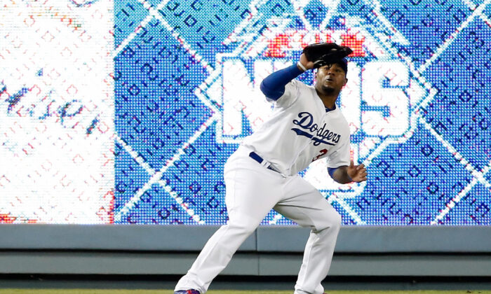 Carl Crawford #3 of the Los Angeles Dodgers makes a catch on a fly ball hit by Yoenis Cespedes #52 of the New York Mets in the fourth inning in game two of the National League Division Series at Dodger Stadium  in Los Angeles, Calif., on Oct. 10, 2015. (Sean M. Haffey/Getty Images)