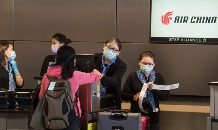 Chinese citizens check in to their Air China flight to Beijing, at Los Angeles International Airport in California, U.S. on Feb. 2, 2020. (MARK RALSTON/AFP via Getty Images)