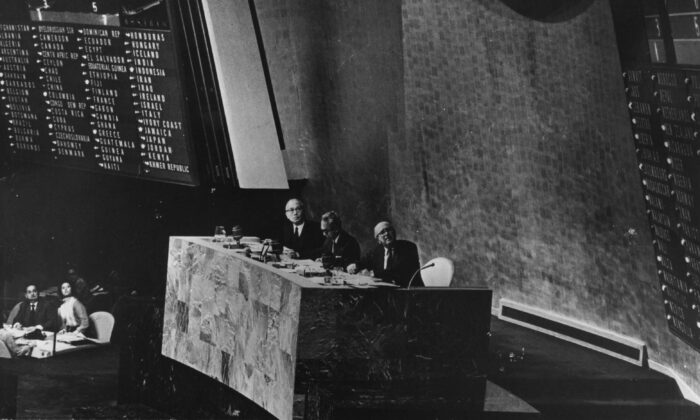 Secretary-General U Thant, Assembly-President Adam Malik and Under-Secretary-General Ca Etavropoulos at the United Nations General Assembly on Oct. 25, 1971, when communist China was voted to replace the Republic of China (Taiwan) as a member state of the U.N. (Keystone/Getty Images)