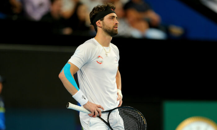 Nikoloz Basilashvili of Team Georgia waits as Pablo Cuevas of Team Uruguay argues with the referees during day six of the 2020 ATP Cup Group Stage at RAC Arena in Perth, Australia, on Jan. 8, 2020. (James Worsfold/Getty Images)
