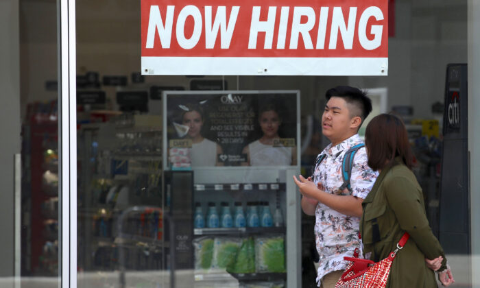 A now hiring sign is posted in the window of a CVS store in San Francisco, Calif., on June 7, 2019. (Justin Sullivan/Getty Images)