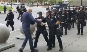 New York Police Officers Suspended After Pushing 75-Year-Old Protester to Ground