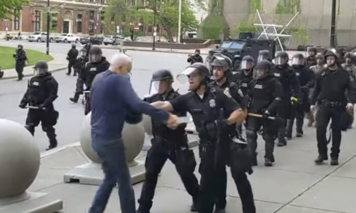 A Buffalo police officer appears to shove a man who walked up to police, in Buffalo, N.Y., on June 4, 2020. (Mike Desmond/WBFO via AP)