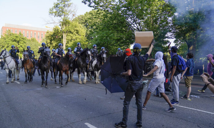 Police on horseback begin to approach demonstrators who had gathered to protest the death of George Floyd, near the White House in Washington on June 1, 2020. (Evan Vucci/AP Photo)