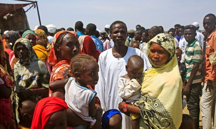 Displaced Sudanese queue to receive humanitarian aid supplies at the Kalma camp for internally displaced people in Darfur's state capital Niyala on Oct. 9, 2019. (Ashraf Shazly/AFP via Getty Images)