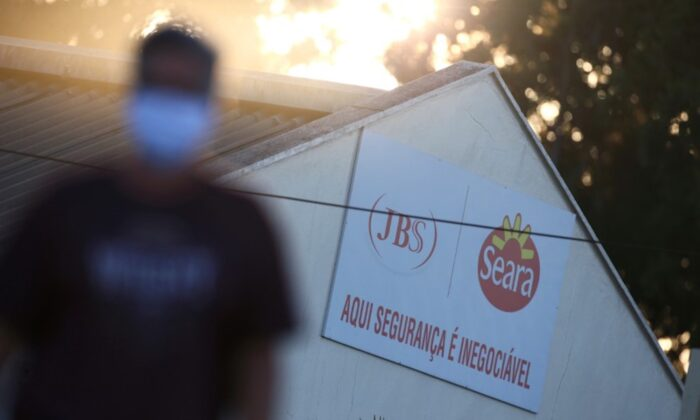 A JBS SA's poultry factory employee is pictured after the company was hit by an outbreak of COVID-19, in Passo Fundo, state of Rio Grande do Sul, Brazil, on April 24, 2020. (Diego Vara/Reuters, File Photo)