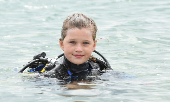 Courageous Schoolgirl Is the 'Youngest in the World' to Swim With Sharks Without a Cage