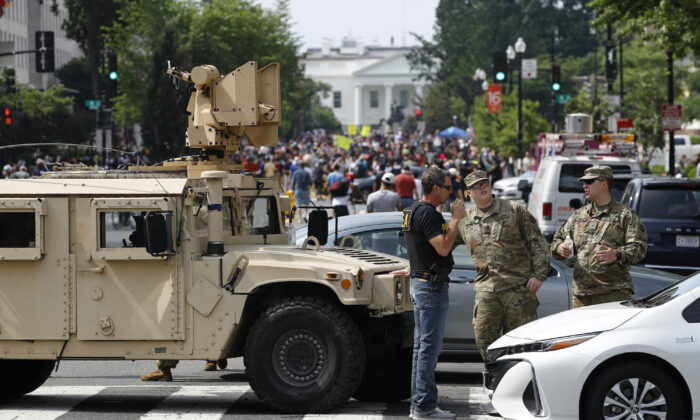 A checkpoint blocks traffic on 16th Street Northwest as people gather near the White House, in Washington, on June 6, 2020. (Patrick Semansky/AP Photo)