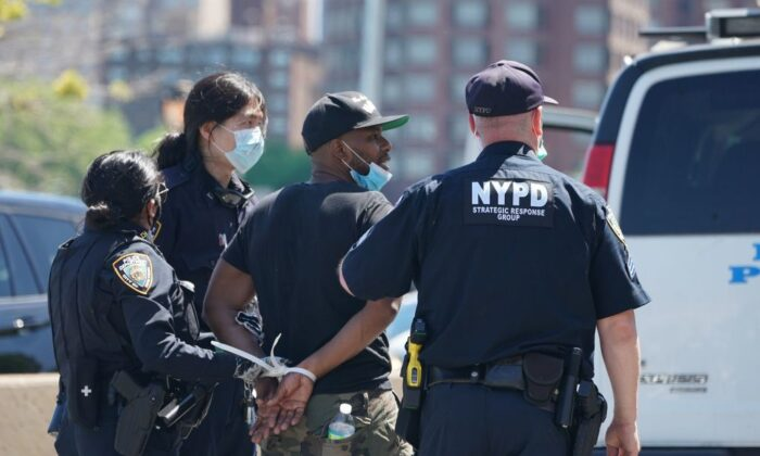 Police arrest protesters walking on FDR Drive, stopping traffic, as they demonstrate over the death of George Floyd by a Minneapolis police officer at a rally in New York on May 30, 2020. (Bryan R. Smith/AFP/Getty Images)