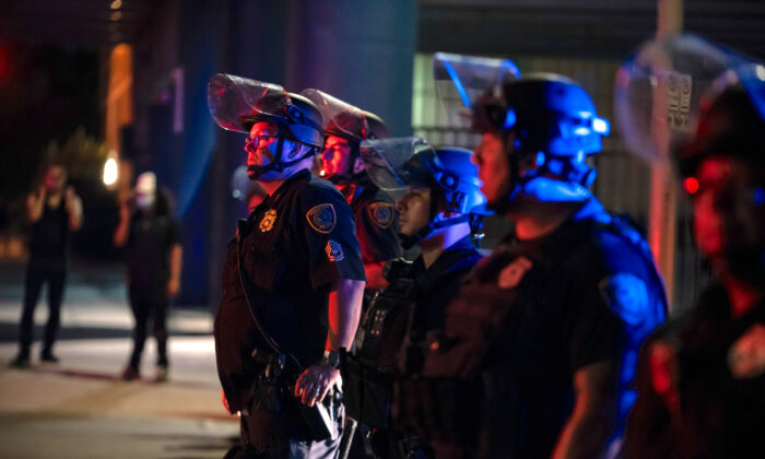 Police officers on the scene of a demonstration in Houston, Texas, on June 2, 2020. (Sergio Flores/Getty Images)