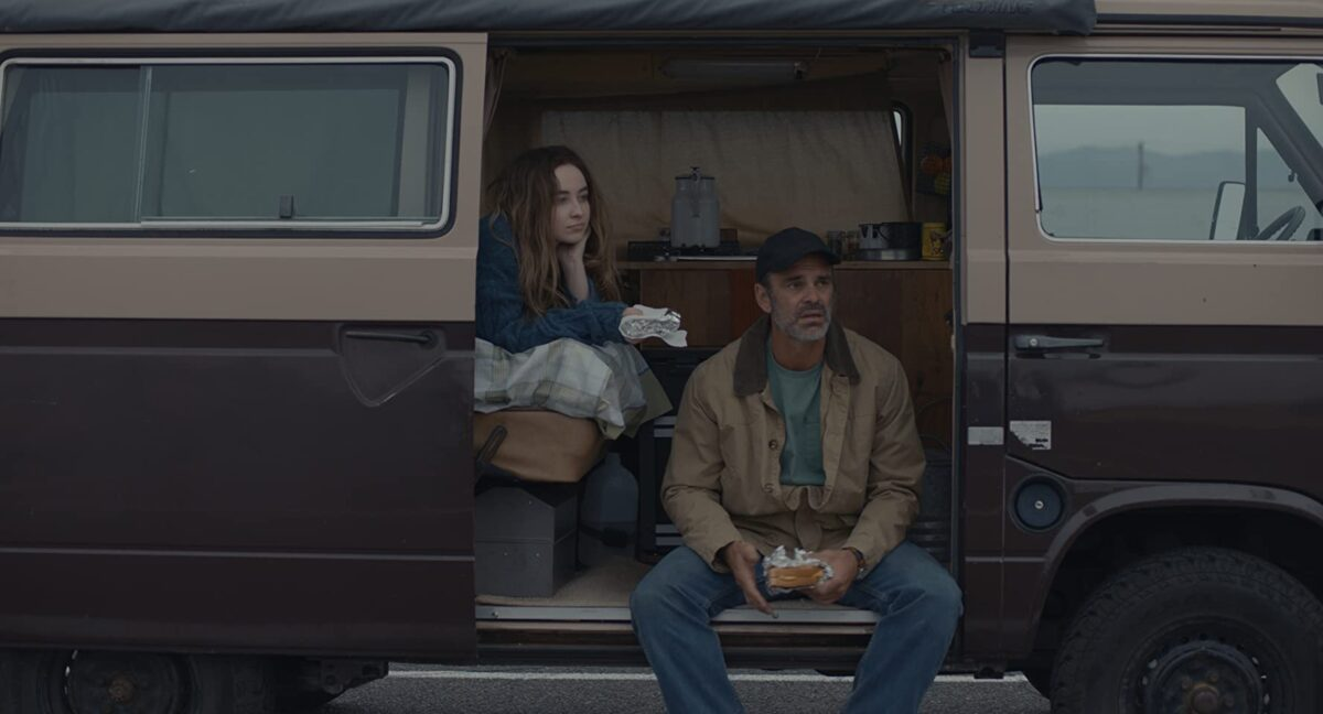"girl and man sit in van in ""The Short History of the Long Road"""