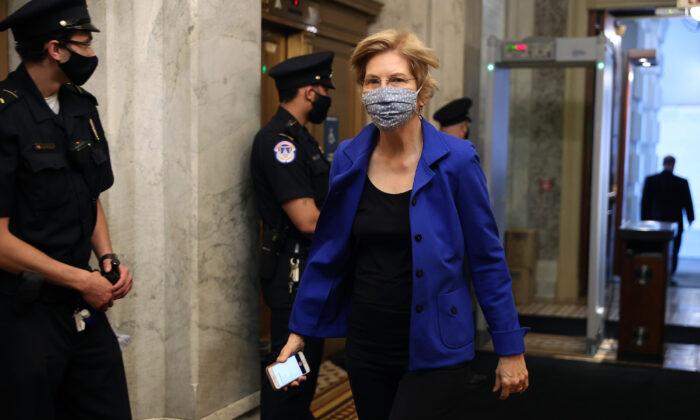Sen. Elizabeth Warren (D-Mass.) arrives at the U.S. Capitol, in Washington for a vote May 18, 2020. (Chip Somodevilla/Getty Images)