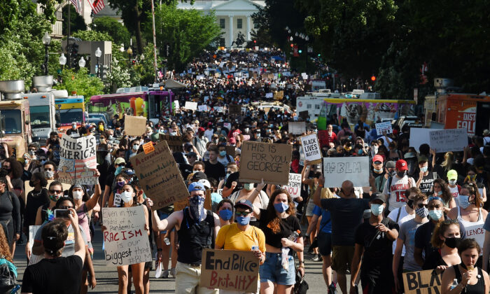 Protesters march near the White House during a demonstration against racism and police brutality on June 6, 2020. (Olivier Douliery/ AFP)