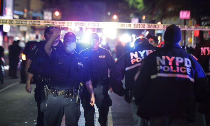 New York Police Officers work a scene on Church Avenue, in the Brooklyn borough of New York on  June 3, 2020. (AP Photo/Frank Franklin II)
