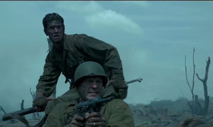 "Medic Desmond Doss (Andrew Garfield) pulls Sgt. Howell (Vince Vaughn) to safety, in ""Hacksaw Ridge."" (Summit Entertainment)"
