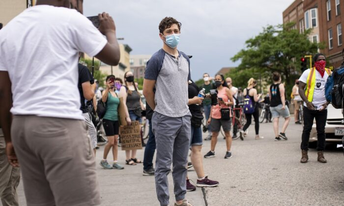 Minneapolis Mayor Jacob Frey looks over a demonstration calling for the Minneapolis Police Department to be defunded in Minneapolis, Minn., on June 6, 2020. Frey spoke at the head of the march but was asked to leave by the organizers after declining to commit to fully defunding the MPD. (Stephen Maturen/Getty Images)