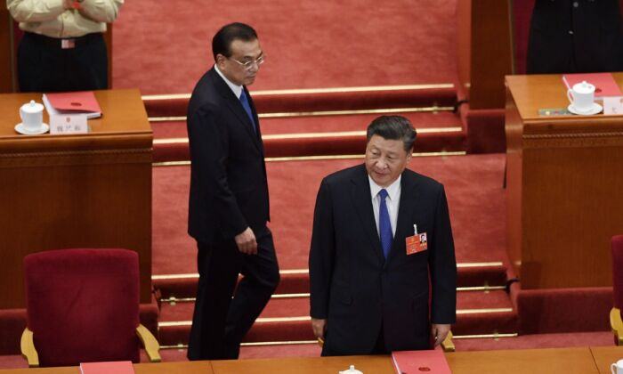 Chinese leader Xi Jinping and Premier Li Keqiang arrive for the closing session of the rubber stamp legislative meeting at the Great Hall of the People in Beijing on May 28, 2020. (NICOLAS ASFOURI/AFP via Getty Images)