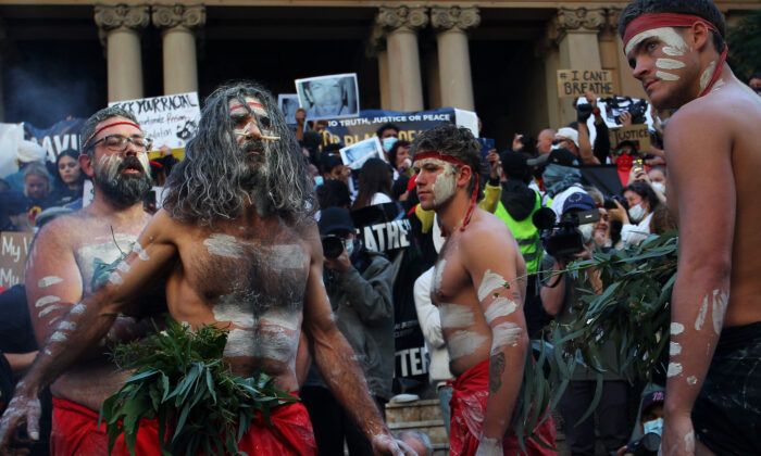 Aboriginal protesters conduct a  traditional smoking ceremony at Town Hall during a protest march, Sydney, Australia, June 06, 2020. (Lisa Maree Williams/Getty Images)