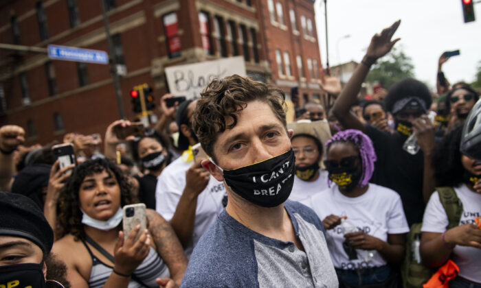 Minneapolis Mayor Jacob Frey leaves after coming out of his home to speak during a demonstration calling for the Minneapolis Police Department to be defunded, in Minneapolis, Minn., on June 6, 2020. Mayor Frey declined when he was asked if he would fully defund the police and was then asked to leave the protest. (Stephen Maturen/Getty Images)