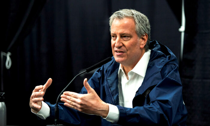New York City Mayor Bill de Blasio speaks to the media during a press conference in Queens on April 10, 2020. (Eduardo Munoz/Reuters)