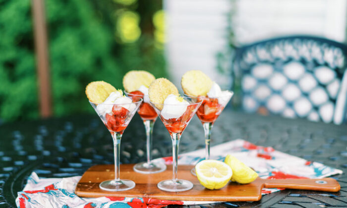 Strawberries and lemon whipped cream in martini glasses, topped with a mini-biscuit, are a fun take on classic strawberry shortcake. (Matt Genders)