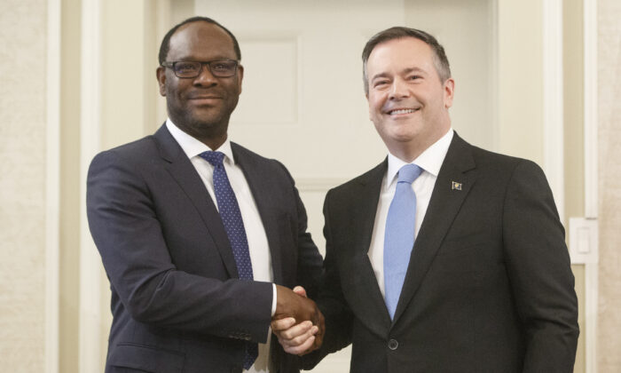 Alberta premier Jason Kenney shakes hands with Kaycee Madu, Minister of Municipal Affairs after being sworn into office in Edmonton on April 30, 2019. (Jason Franson/The Canadian Press)