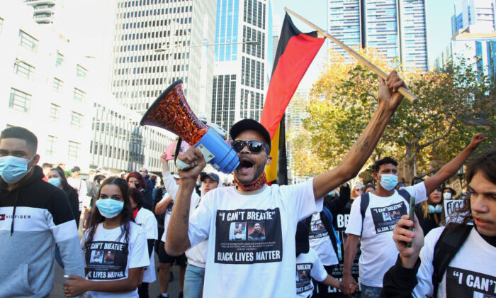 Protesters chant and hold placards at Town Hall during a 'Black Lives Matter' protest march June 06, 2020 in Sydney, Australia. Events across Australia have been organised in solidarity with protests in the United States following the killing of an unarmed black man George Floyd at the hands of a police officer in Minneapolis, Minnesota and to rally against aboriginal deaths in custody in Australia. (Lisa Maree Williams/Getty Images)