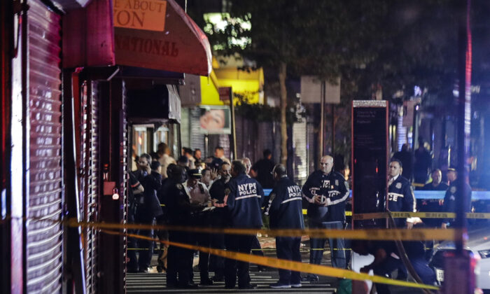 New York City police officers gather near the site of a shooting in Brooklyn on June 4, 2020. (Frank Franklin II/AP Photo)