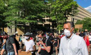 Sen. Mitt Romney Walks With Protesters in Washington