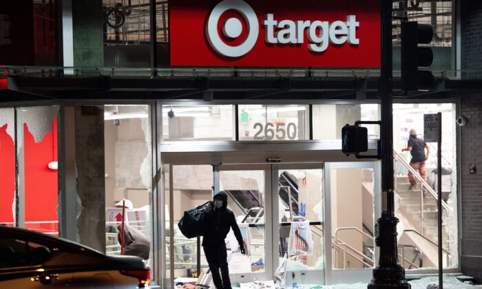 A looter robs a Target store in Oakland, Calif., on May 30, 2020. Three Antifa members were arrested for allegedly participating in the looting of a Target in Texas on May 31, 2020. (Josh Edelson/AFP via Getty Images)