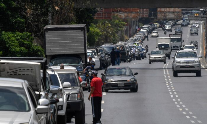Drivers queue to refuel the tanks of their cars near a gas station, in Caracas on June 3, 2020, amid the novel COVID-19 coronavirus outbreak. (Federico Parra/AFP via Getty Images)