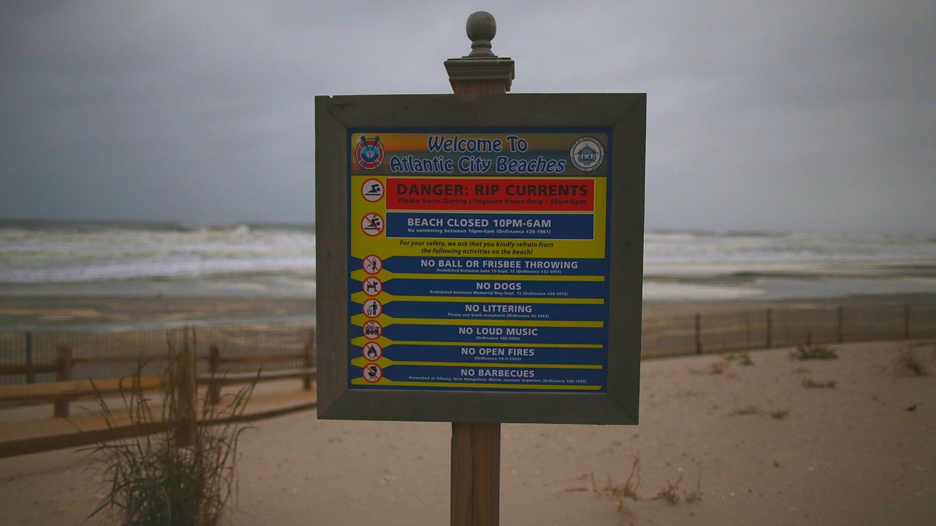 """A sign announces """"Danger Rip Current"""""""