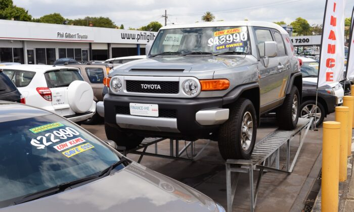A Toyota vehicle is displayed at a Toyota dealership in Sydney on December 12, 2013, as Australian Prime Minister Tony Abbott sought talks with Toyota to persuade the Japanese giant to keep its plants open and prevent a collapse of Australia's car manufacturing industry.  Abbott acted after US-based General Motors on December 11 announced its Holden offshoot will cease manufacturing in Australia by 2017 after 65 years, prompting Toyota to warn it too was in peril as unions said the car industry was finished.  AFP PHOTO/William WEST        (Photo credit should read WILLIAM WEST/AFP via Getty Images)