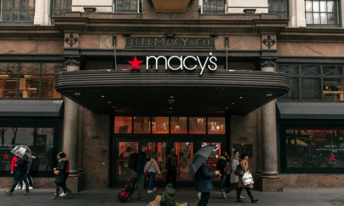 People walk by the entrance to the Macy's flagship store on 34th Street in Midtown Manhattan in New York City, on Feb. 25, 2020. (Scott Heins/Getty Images)