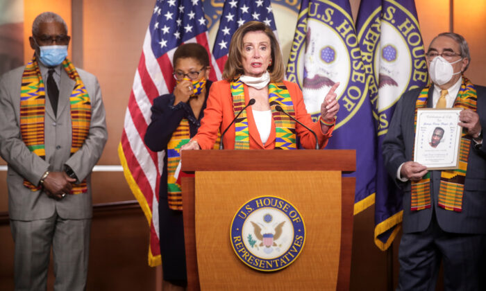 House Speaker Nancy Pelosi (D-Calif.) stands with members of the Congressional Black Caucus during a news conference to unveil legislation to combat police violence and racial injustice at the U.S. Capitol in Washington on June 8, 2020. (Jonathan Ernst/Reuters)